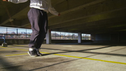 Slow motion clip of legs skipping energetically in urban setting