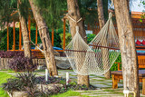 Large white polyester rope hammocks for relaxation poster