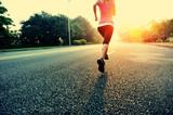 Fototapety woman runner running at sunrise road
