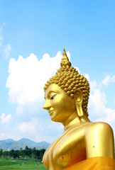 Golden THAI Buddhism statue with sky background