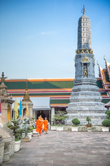 Thai art temple with monk under blue sky, Bangkok, Thailand