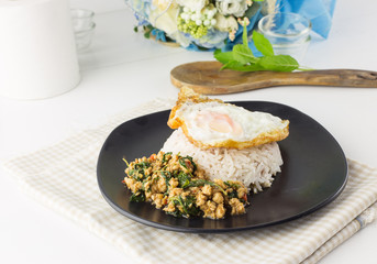 Dish of rice - egg and stir fried chiicken with basil