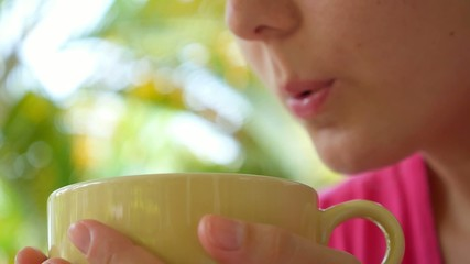 Woman Enjoying a Large Cup of Brewed Hot Tea. Slow Motion.