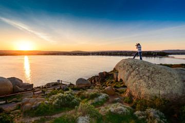 A man on the rock on a sunset