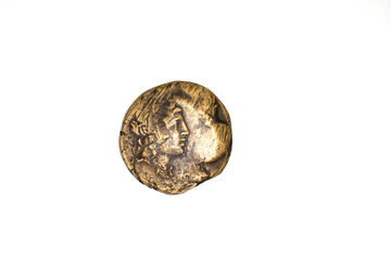 One ancient coin with  Dionysus on a white background