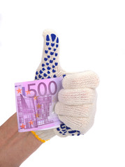 ..the human hand in white blue glove holds five hundred euros