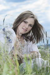 Portrait of beautiful young woman in a meadow