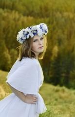 Portrait of beautiful young woman wearing wreath