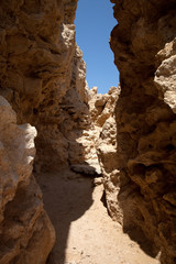 Crevice in the rock, forming a tunnel. tinted