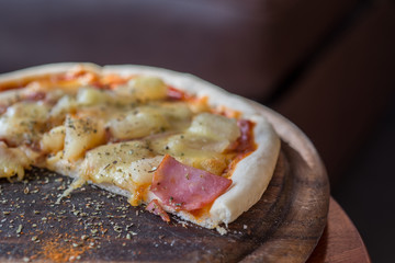 hawaiian Pizza , pineapple , ham and cheese on wooden tray