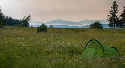 Tent on the grass meadow.