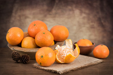 Still life with fresh mandarins in a basket