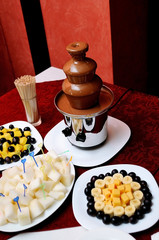 Chocolate fountain and fruits at wedding reception