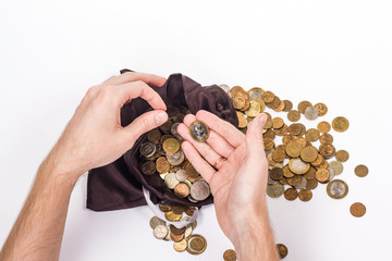 two man's hands holding a money