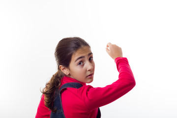 Girl writes on the blackboard