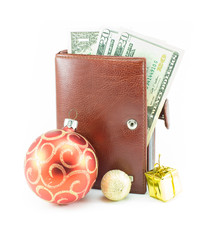 Money in leather wallet and christmas toy