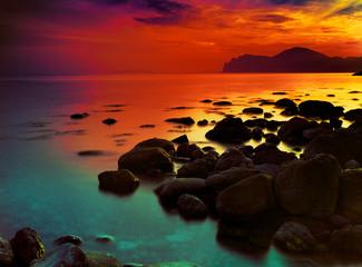 Beautiful sunset over rocky coast