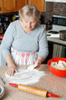 Senior woman making pie