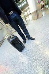 Man waiting with bag at airport