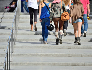 Young people walking up the stairs