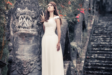 Woman walking near mystery of the abandoned hotel in Bali