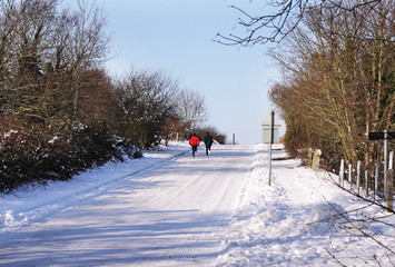 English Winter Rural Landscape with two Joggers on a road