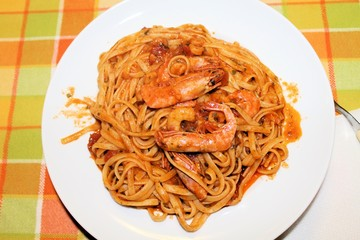 pasta with prawns and shrimp with tomato sauce
