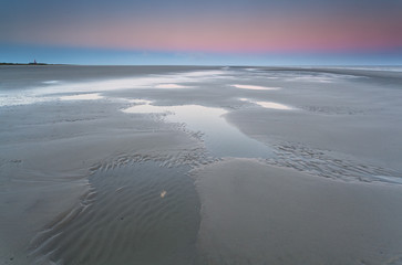 low tide on North sea and sunrise