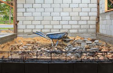 Old rusty wheelbarrow in construction site