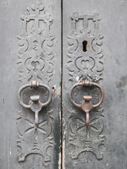knob and lock of an ancient grey wooden door