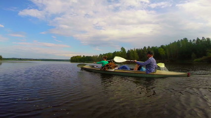 Young girl and guy paddling canoe fast, active lifestyle, sport