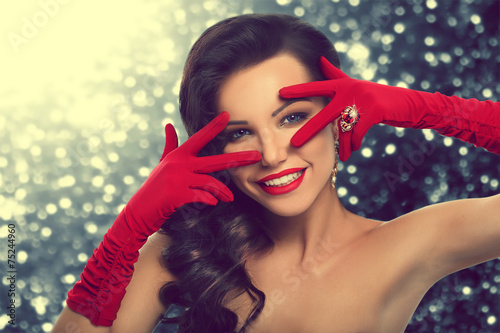 Poster gay glamorous girl in red gloves and jewelry