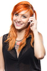 Red-haired cute young girl talking on a smartphone