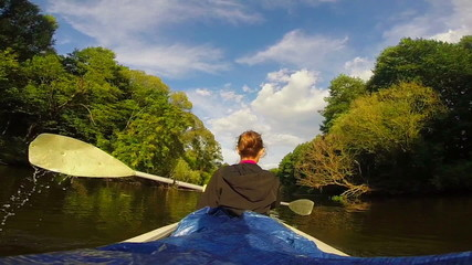 Female tourist kayaking on river, vacation, sport, slow motion