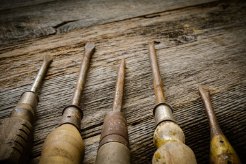 Rustic Screwdrivers on Wood Background