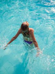 Top view of a woman in bikini at the pool