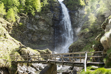 Wooden bridge and waterfall