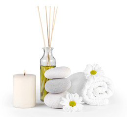Spa decoration with stones, daisies, candles and  massage oil