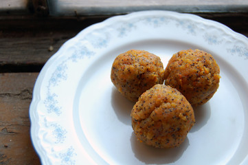 carrot truffles with poppy seeds on a dessert plate