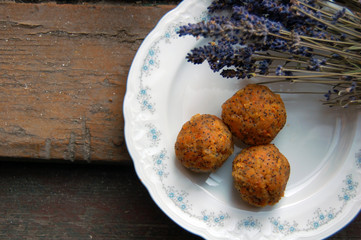 carrot truffles with lavender on a dessert plate