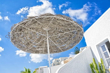 Beach umbrella with blue sky and clouds