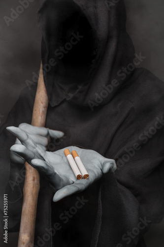 The concept: smoking kills. Angel of death holding cigarette - 75255971