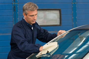 Man Cleaning Car With A Cloth