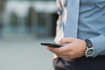 Businessman Holding Smartphone