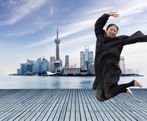 Bund and the Huangpu River.Beautiful female graduate