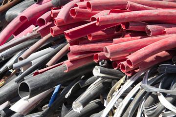 a pile of scrap plastic cables
