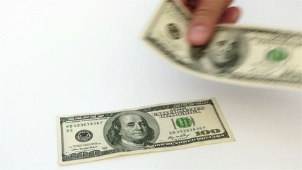 counting USD paper currency on white