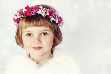 Beautiful little girl wearing floral wreath