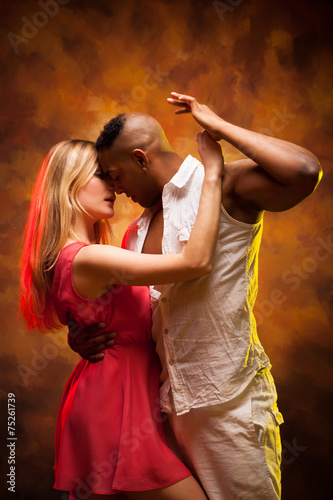 Young couple dances Caribbean Salsa - 75261739