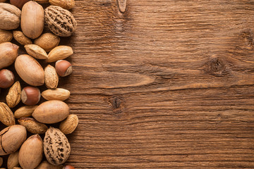 Assorted nuts on a wooden background